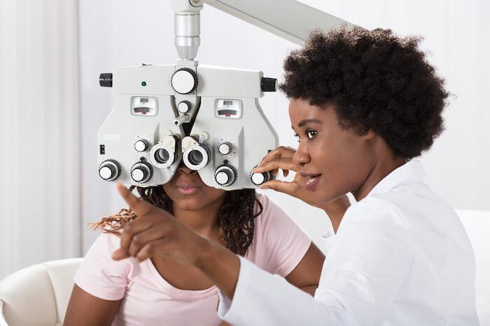 Optometrist giving an eye exam